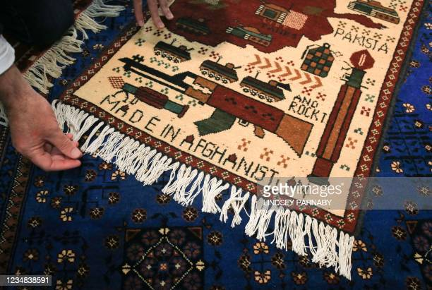 Picture shows one of the rugs at The Afghan Rug Shop in Hebden Bridge, northern England, on August 20, 2021. - Overseas businesses selling colourful...