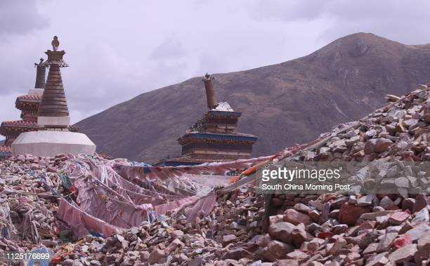 Picture shows part of the Gyanag Mani Wall, the largest mani stone wall in the world, in Jiegu, Yushu, Qinghai, April 11, 2011. A devastating...
