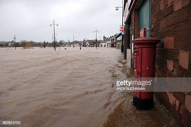 Picture shows pedestrian areas and roads flooded along the River Nith that burst its banks in Dumfries, southern Scotland, on December 30, 2015 after...