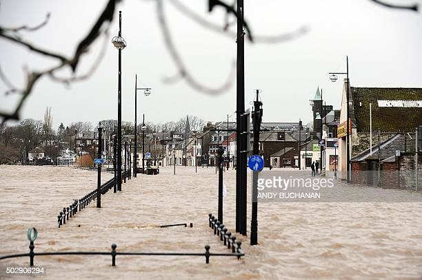 Picture shows pedestrian areas flooded along the River Nith that burst its banks in Dumfries, southern Scotland, on December 30, 2015 after heavy...