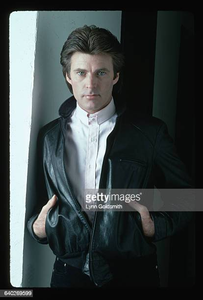 1981 Picture shows performer Ricky Nelson leaning against a wall He is wearing a black leather jacket and a white high collar shirt