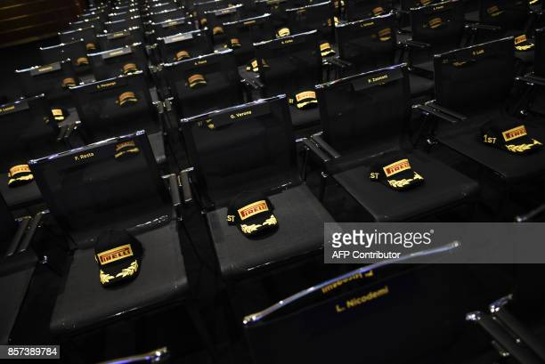 A picture shows Pirelli's caps on chairs before a ceremony to mark the comeback of Italian tire maker Pirelli at Milan's stock on October 4 2017...