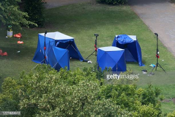 A picture shows police tents and equipment at the scene of a fatal stabbing incident that is being treated as terrorism in Forbury Gardens park in...