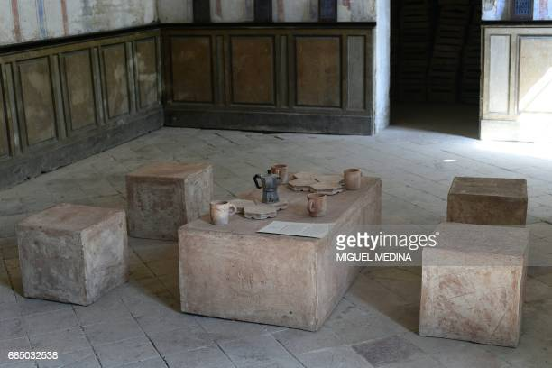 A picture shows potteries and furnitures made from 'Merdacotta' on march 28 2017 at the Shit Museum in the Castelbosco castle of Gragnano Trebbiense...