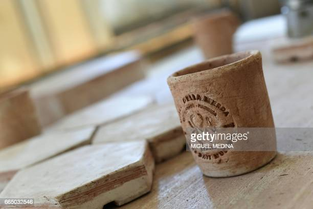 A picture shows potteries and tiles made from 'Merdacotta' on march 28 2017 at the Shit Museum in the Castelbosco castle of Gragnano Trebbiense The...