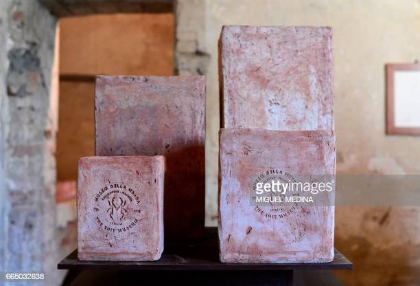 A picture shows potteries made from 'Merdacotta' on march 28 2017 at the Shit Museum in the Castelbosco castle of Gragnano Trebbiense The idea of the...