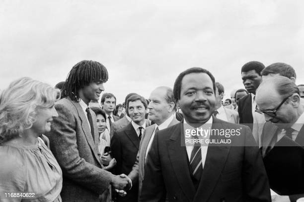Picture shows President of Cameroon Paul Biya welcoming his French counterpart François Mitterrand , French tennisman Yannick Noah and Marie-Claire...