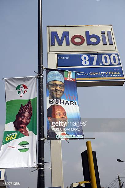 A picture shows presidential campaign posters of Nigerian President and candidate to his reelection for the ruling People's Democratic Party Goodluck...