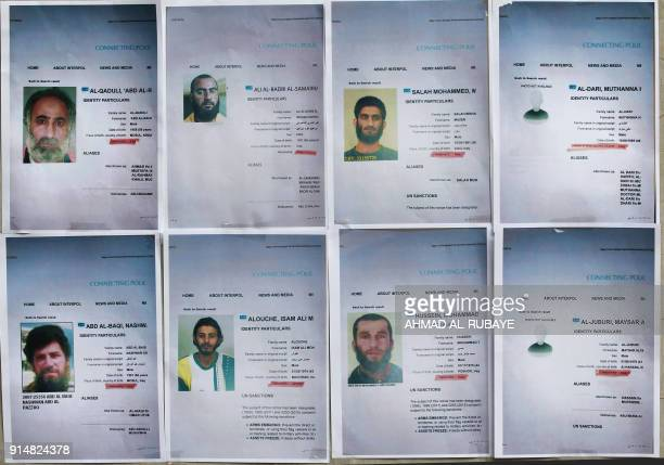 A picture shows printed profiles of Islamic State group members released by Iraqi authorities on February 6 2018 in Baghdad Iraqi authorities issued...