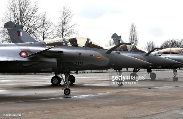 A picture shows Rafales with Qatar's colours during a ceremony for the delivery to Qatar of the first of 36 Rafale multipurpose jet fighters from...