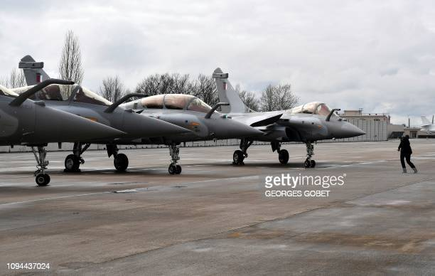 Picture shows Rafales with Qatar's colours during a ceremony for the delivery to Qatar of the first of 36 Rafale multi-purpose jet fighters from...