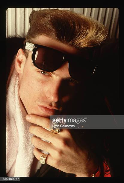 1991 Picture shows rapper Vanilla Ice posing with a towel around his neck a pair of sunglasses and his hand resting on his chin