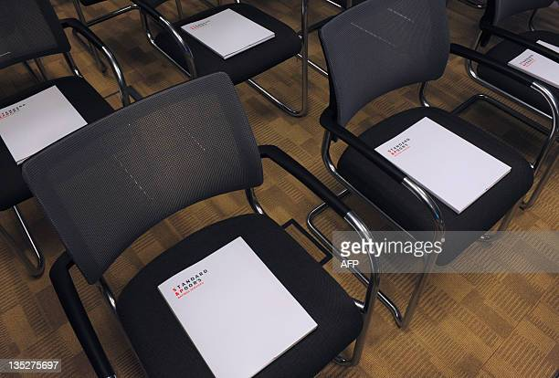 "Picture shows ratings agency Standard & Poor's press releases prior to the start of a yearly press conference about ""macro economic outlook and..."