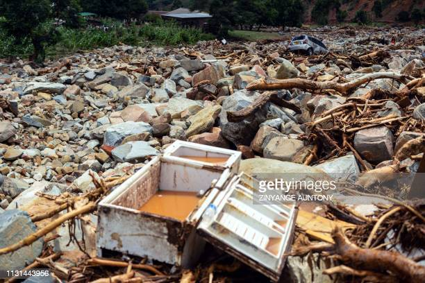 A picture shows rock and a damaged fridge among debris on March 18 2019 in Ngangu township Chimanimani Manicaland Province eastern Zimbabwe after the...