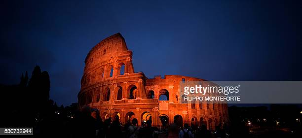 A picture shows Rome's Colosseum lit up to mark 150 years of diplomatic relations between Italy and Japan during a visit by the Japanese prince on...
