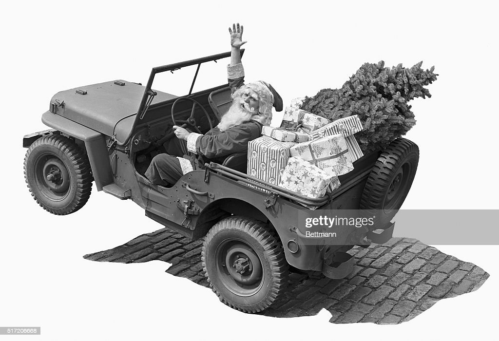 Christmas Jeep.Picture Shows Santa Claus In A Jeep With A Christmas Tree