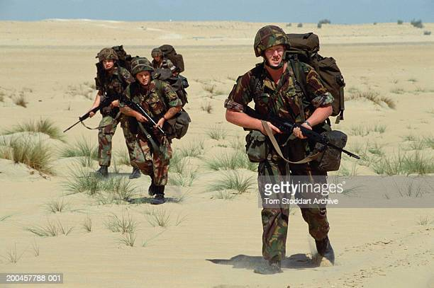 Picture shows Sapper Gary Williams from the Staffodshire 39th Royal Engineers Regiment leading a patrol during desert training in Saudi Arabia before...