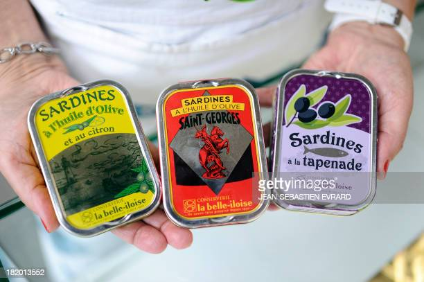 Picture shows sardine tins on September 25 2013 in Quiberon western France at the canning factory 'La Belle Iloise' The company employs 200 employees...