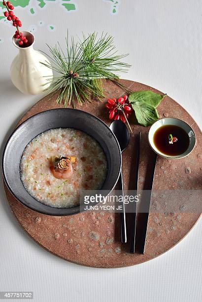 A picture shows seafood congee during the Hansik Week for the Korean food culture in Seoul on October 24 2014 AFP PHOTO / JUNG YEONJE