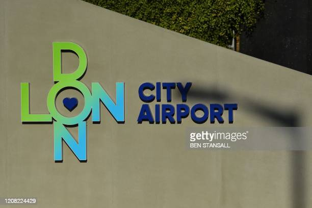 Picture shows signage at London City Airport in east London on March 25, 2020. - London City Airport, located close to the British capital's...