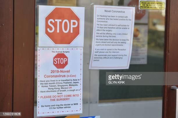 A picture shows signage at the front of the Avenue Surgery health centre in Brighton southern England on February 12 which is offering a very limited...