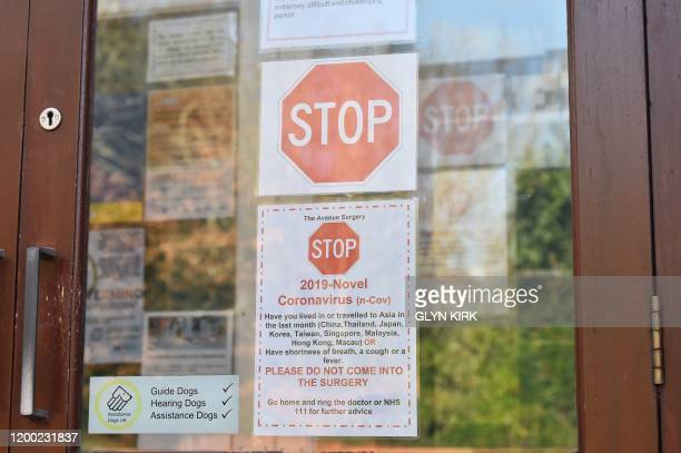 Picture shows signage at the front of the Avenue Surgery health centre in Brighton, southern England on February 12 which is offering a very limited...