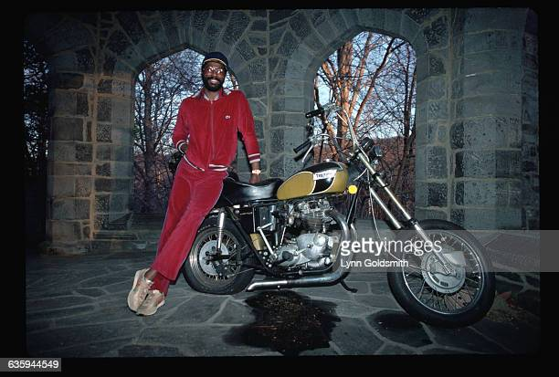 1980 Picture shows soul singer Teddy Pendergrass leaning on a motorcycle in a stone atrium outside