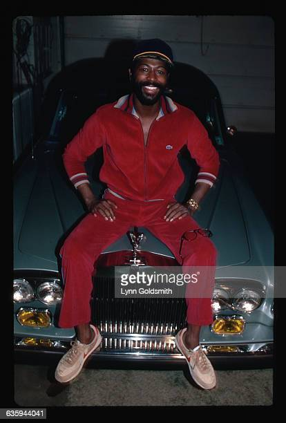 1982 Picture shows soul singer Teddy Pendergrass seated on a Rolls Royce with a pair of glasses resting on his leg