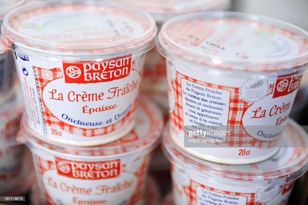 BAERT - A picture shows sour cream pots of the French brand 'Paysan Breton' on April 24, 2013 at the Laïta plant in Yffiniac, Brittany.