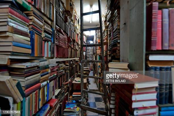 """Picture shows stacks of books at a second-hand book shop called """"Cave of Ali Baba"""", in the capital Tunis, on November 8, 2020."""