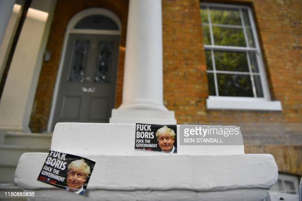 A picture shows stickers outside on the wall outside the home of Conservative MP and Conservative leadership contender Boris Johnson in London on...