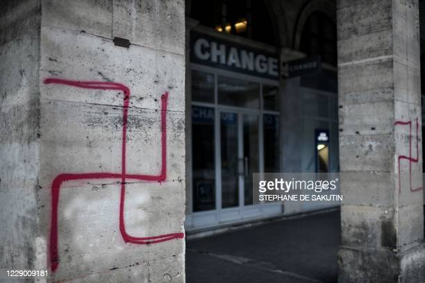 Picture shows swastikas spray painted on columns of the Rivoli street in central Paris on October 11, 2020.