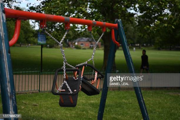 A picture shows swings tied up in a children's playground in the Highfields area of Leicester central England on July 17 as local lockdown...