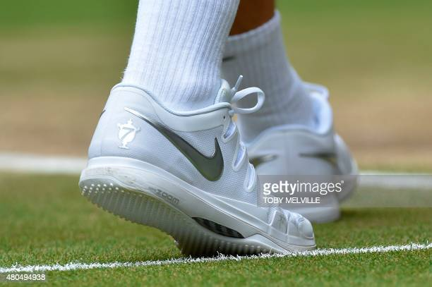 A picture shows Switzerland s Roger Federer shoes bearing the number seven  which is the number of 6fdd5ee3d