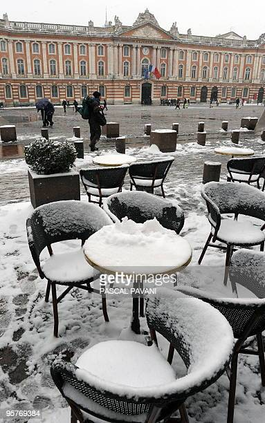 A picture shows tables covered by snow outside a cafe of the Capitole square on January 9 2010 in Toulouse southwestern France Meteo France posted...