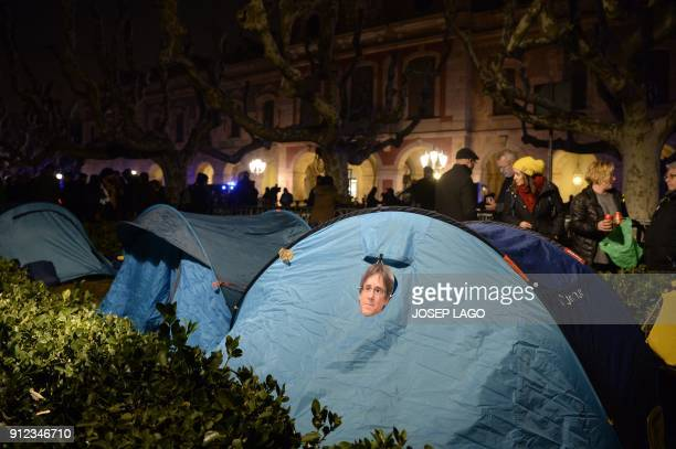 Picture shows tents some of them with masks depicting ousted separatist leader Carles Puigdemont set up outside the Catalan parliament at the...
