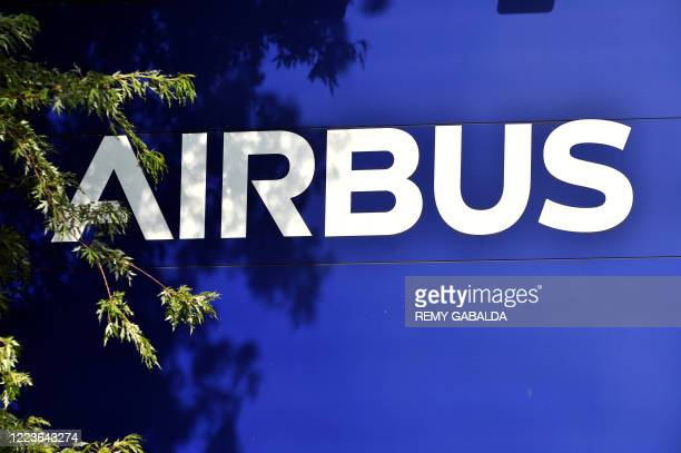 Picture shows the Airbus logo outside the company headquarters in Blagnac, southern France, on June 30, 2020. - European aircraft maker Airbus said...