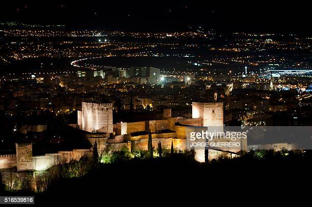 Picture shows the Alhambra in Granada before being turned off during the global climate change awareness campaign 'Earth Hour' on March 19 2016 Many...