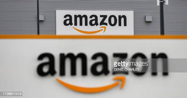 deca89316d6 A picture shows the Amazon logo at the entrance area of the Amazon  logistics centre in