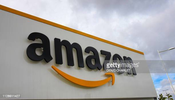 A picture shows the Amazon logo at the entrance area of the Amazon logistics centre in LauwinPlanque northern France on March 4 2019