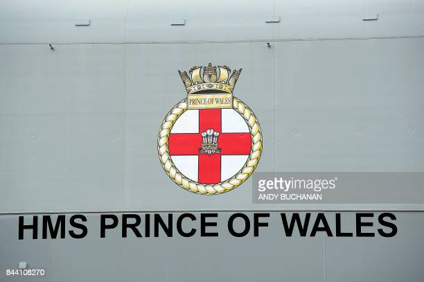 A picture shows the badge of the Prince of Wales and the name written on the hull of the QE Class aircraft carrier HMS Prince of Wales the second of...