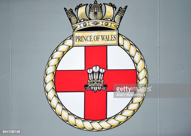 A picture shows the badge of the Prince of Wales on the side of the QE Class aircraft carrier HMS Prince of Wales the second of the Royal Navys two...