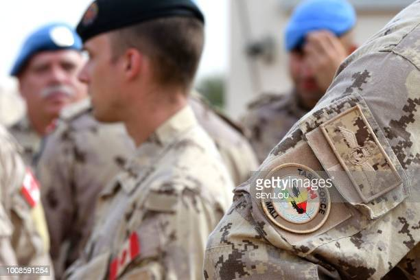 A picture shows the badge on a sleeve of a Canadian soldier of the MINUSMA force at the contigents' camp in Gao on July 31 2018 Canadian troops have...