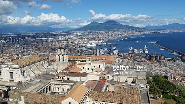 A picture shows the bay of Naples and the Vesuvius volcano in the background on May 23 2015 AFP PHOTO / DANIEL SLIM