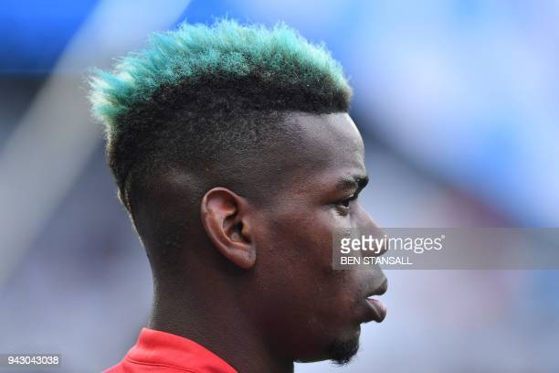 A picture shows the blue hair of Manchester United's French midfielder Paul Pogba during the English Premier League football match between Manchester...