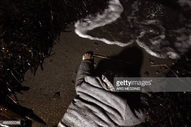A picture shows the body of a child washed up ashore on the Greek Lesbos island on November 1 2015 More than 218000 migrants and refugees crossed the...
