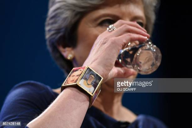 A picture shows the bracelet of Britain's Prime Minister Theresa May as she delivers her speech on the final day of the Conservative Party annual...