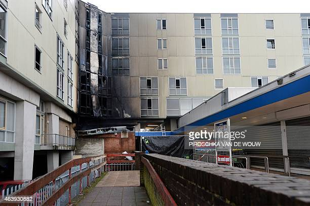 A picture shows the burnt section of an apartment complex for the elderly after a fire broke out at the cafeteria in the Otto C Huismanstraat in...