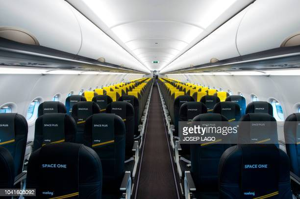 TOPSHOT Picture shows the cabin of the new Airbus A 320 neo aircraft model presented by the Spanish lowcost airline Vueling at Barcelona's airport in...