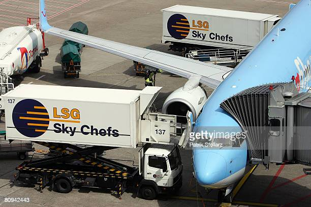Picture shows the catering service of 'Sky Chefs' on a parking TUI Airbus A300 at the airport Duesseldorf on April 30 2008 in Duesseldorf Germany
